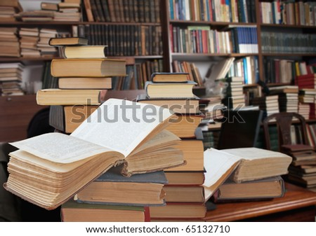 open books in a library - stock photo