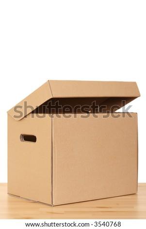 open box on the floor - isolated on white - stock photo