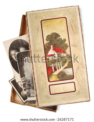 Open box with old family photographs - stock photo