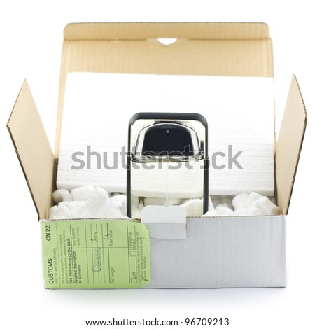 Open box with packing 'peanuts' and perfume isolated on white - stock photo