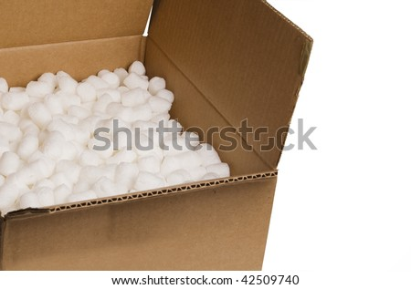 open box with packing 'peanuts' inside on the plain background - stock photo