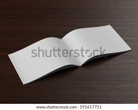 Open  brochure on a wooden table - stock photo