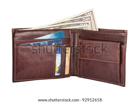 Open brown leather wallet with cash and credit cards in it. Image is isolated on white and the file includes a clipping path. - stock photo