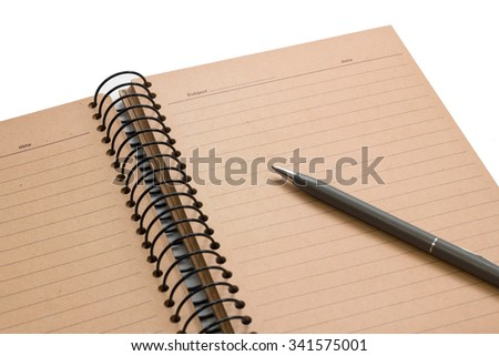 open brown note book with lined and gray pen on white background - stock photo