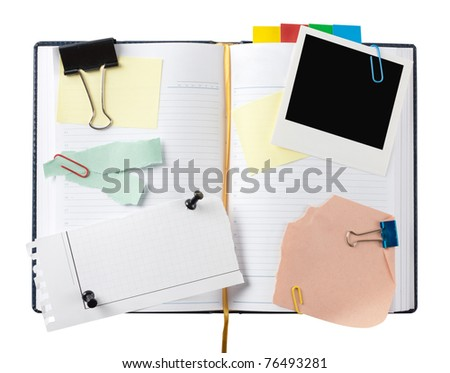 Open business diary with clipped papers. Isolated on white - stock photo