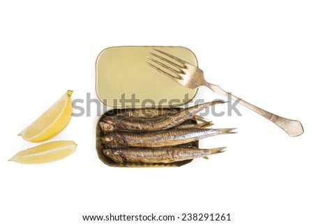 Open can with grilles sardines isolated on white background, top view with lemon slice and fork isolated on white background. Culinary seafood eating.  - stock photo