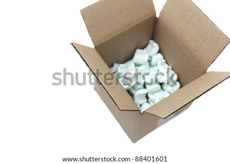 Open cardboard box with styrofoam peanuts. Selective focus, Isolated on white background, copy space
