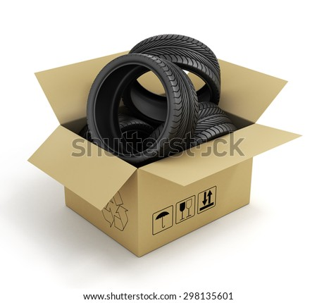 Open Cardboard Box with Tires on white background. Online store of auto parts. - stock photo