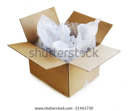 Open cardboard box with tissue paper and bubble wrap. - stock photo