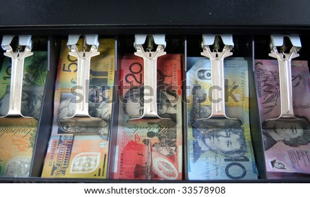 Open cash drawer filled with various Australian currency notes - stock photo