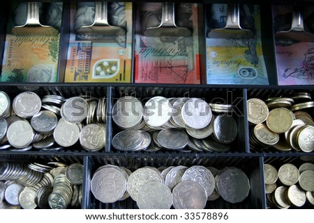 Open cash register with Australian currency, notes and coins - stock photo