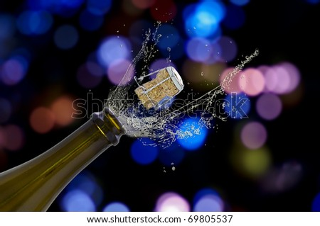 Open champagne bottle with an amazing light background