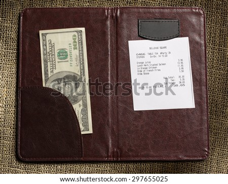 Open check folder with bill and money - stock photo