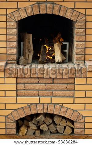 Open chimney with burning wood - stock photo