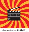 Open clapboard on red beams background. - stock photo