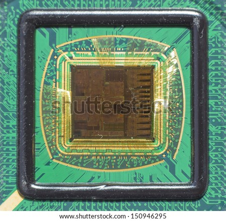 Open computer chip with gold wire connections - stock photo