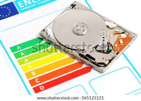Open  computer hard disc and energy efficiency chart - stock photo