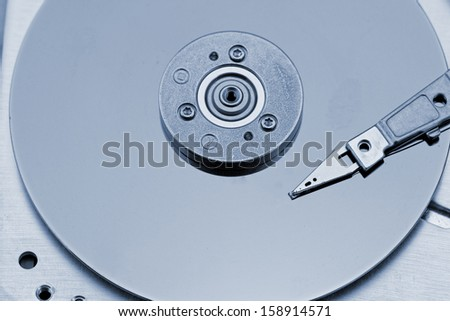Open computer hard drive on white background with blue (HDD, Winchester)