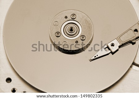 Open computer hard drive on white background with rusty color (HDD, Winchester)
