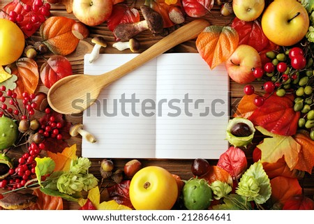 open cookbook. blank recipe book and food ingredients - stock photo