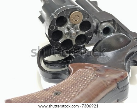 open cylinder of revolver with one bullet inside - stock photo