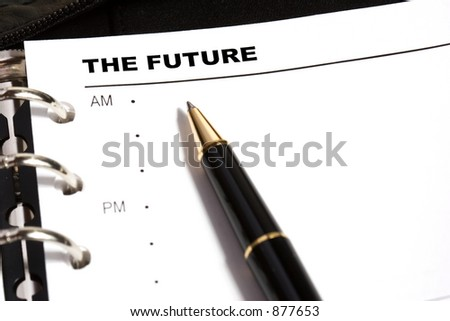 Open day planner with a ballpoint pen pointing to THE FUTURE. - stock photo