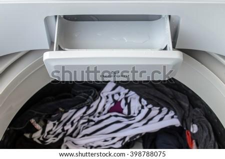 Open detergent dispenser on a washing machine - stock photo
