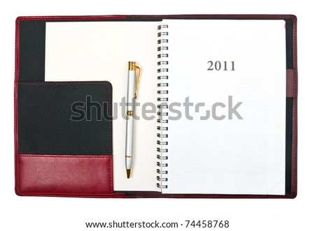 Open diary for year 2011 and pen over white