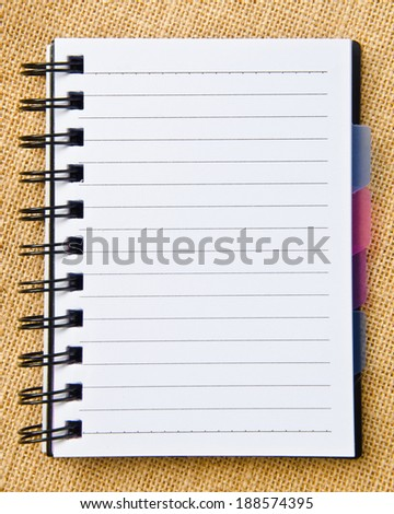 open diary ring binder on sack background. - stock photo