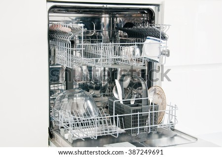 Open dishwasher with the dishes inside,italy - stock photo