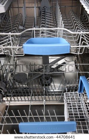 open dishwasher without dishes in kitchen - stock photo