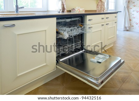 open dishwashing machine in the kitchen