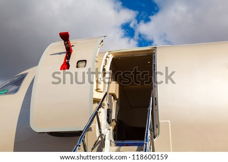 open door and cocpit in private jet against the blue sky - stock photo