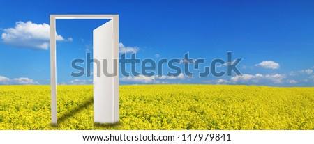 Open door in a rape field  - stock photo