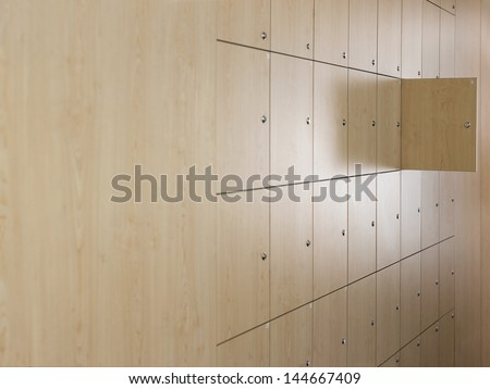 Open door in locker room at office - stock photo
