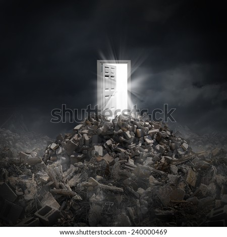 Open door light and the resilient power of hope as a symbol of shinning rays of human aspiration concept escaping from a dark scene of destruction and disaster after a crisis. - stock photo