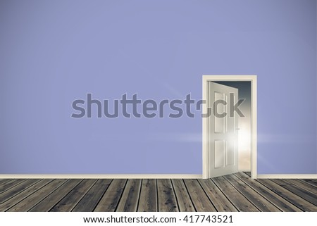 Open door on green wall against a beautiful sunset on a beach - stock photo