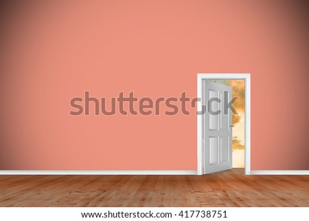 Open door on green wall against landscape with sunset - stock photo