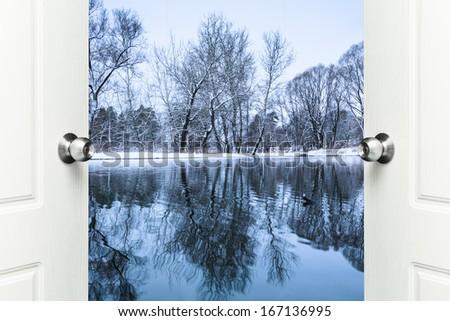 open door overlooking a winter landscape - stock photo