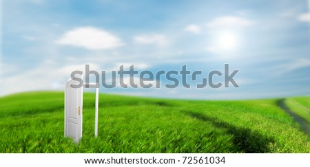 Open door to new life on the field. Hope, success, new life and world concepts. - stock photo