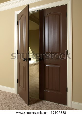 Open Double Dark Wood Door to Bathroom - stock photo