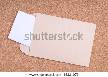 Open Envelope with blank label and paper on cork background - stock photo