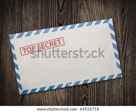 Open  envelope with top secret stamp, on wooden table, clipping path. - stock photo