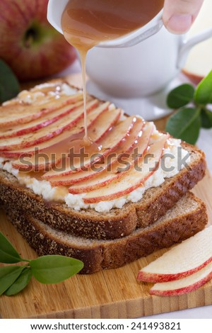 Open faced sandwich with ricotta, apple and caramel sauce - stock photo