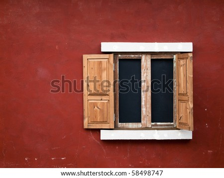 open fake wood window on red wall - stock photo