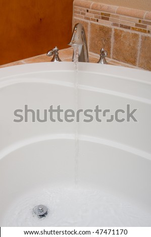 "Open Faucet. Water Running into Bath-Jacuzzi.  Water-overflow ""circle"" removed for cleaner image. Vertical"