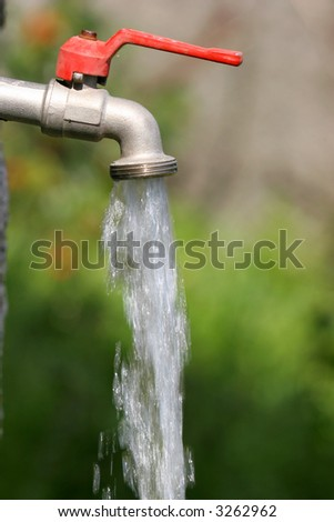 open faucet with running water - stock photo