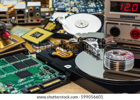 open faulty SSD and HDD in a service laboratory ready for data recovery or repair