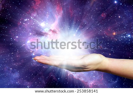 open female hand holding a powerful light - Elements of this image furnished by NASA - stock photo