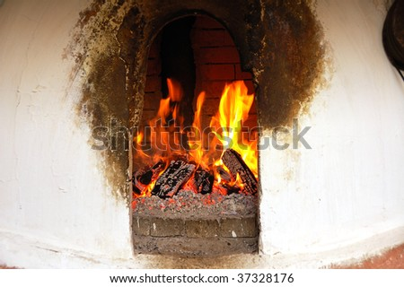 open fire in limewhiting oven